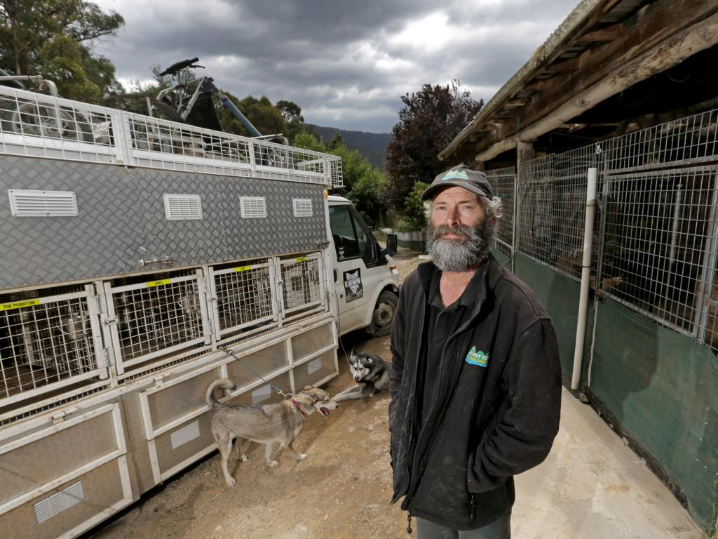 Sled Dog Adventures Tasmania co-owner Peter Devries is prepared to evacuate with his 27 rescued Siberian Husky sled dogs from their property at Lonnavale. Picture: PATRICK GEE