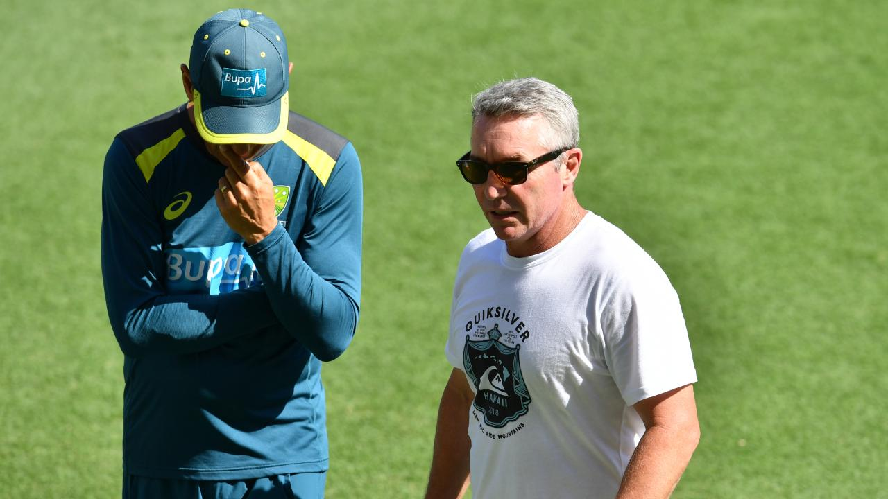 North Queensland Cowboys coach Paul Green (right) is seen during the Australian Cricket team training session at the Gabba in Brisbane,