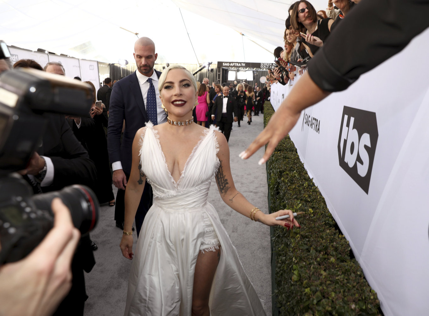 Lady Gaga interacts with fans at the 25th annual Screen Actors Guild Awards in Los Angeles.