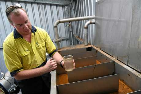 Shift supervisor Rob Stephens with a sample from the turps and water separator.