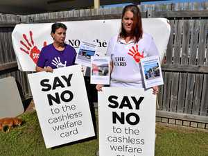 Protesters take to streets as cashless card rolls out today