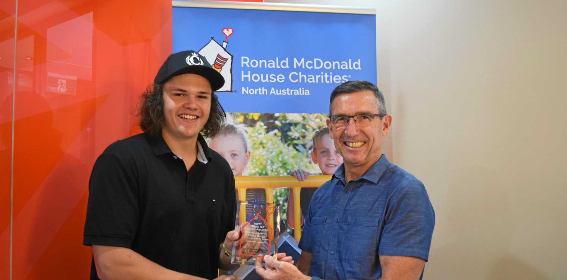 BUSINESS BUFF: Kaelan Gough received the Charlie Bell Scholarship from McDonald's Airlie Beach, Cannonvale and Bowen owner Mike Muller on behalf of Ronald McDonald House Charities.