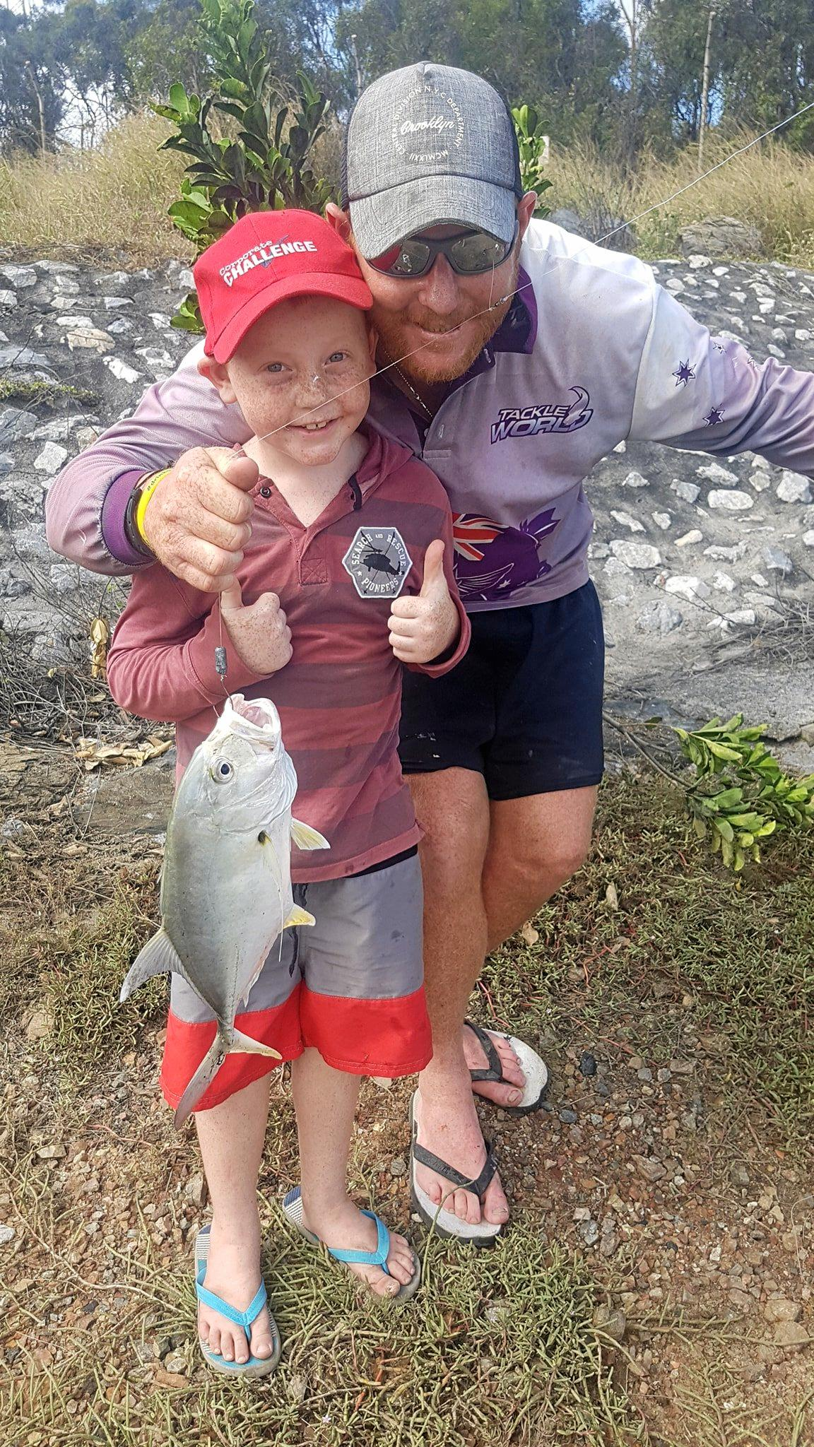 Preston Toms, with his father Josh, and the trevally caught by himself on Australia Day.