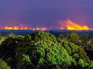 Fire burns through 1000ha as crews expand containment lines