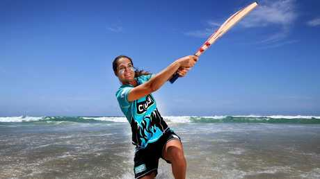 Josie Dooley, pictured at Surfers Paradise, is also a keen surfer. Picture: Adam Head