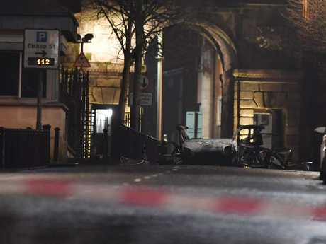 The remains of the car that was earlier hijacked and packed with explosives before being detonated is left outside Derry court house. Picture: Getty