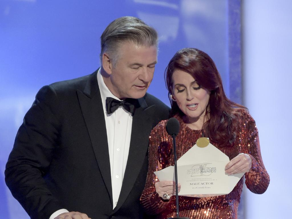 Alec Baldwin, left, and Megan Mullally present the award for outstanding performance by a male actor in a comedy series at the 25th annual Screen Actors Guild Awards. Picture: AP