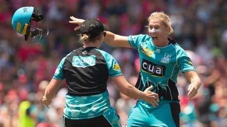 Delissa Kimmince hurls off her helmet after the Heat secured their WBBL championship. Picture: Steve Christo