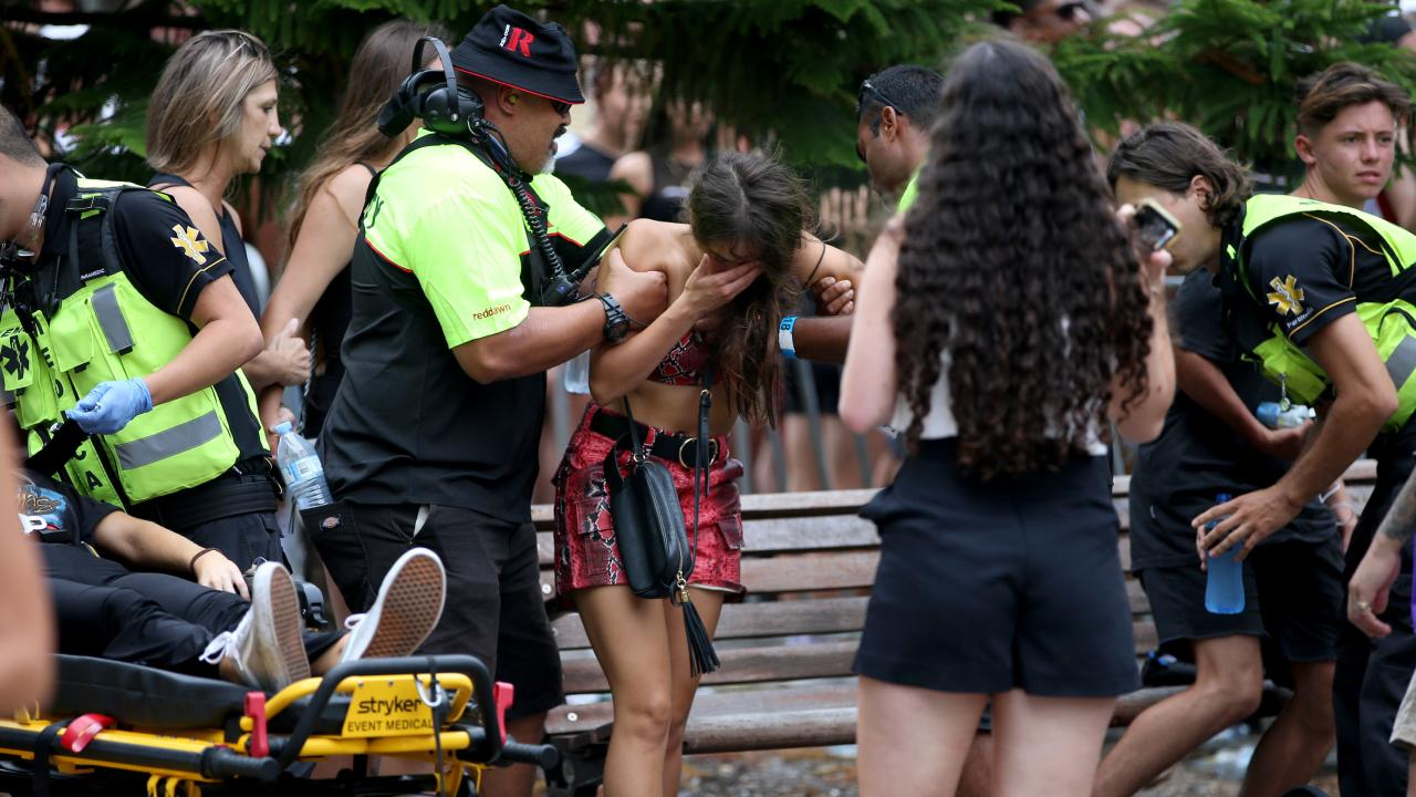 Two young girls are helped by specialist ambulance crews at Hardcore Till I Die. Picture: Damian Shaw