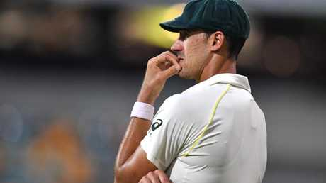 Mitchell Starc contemplates his bowling.