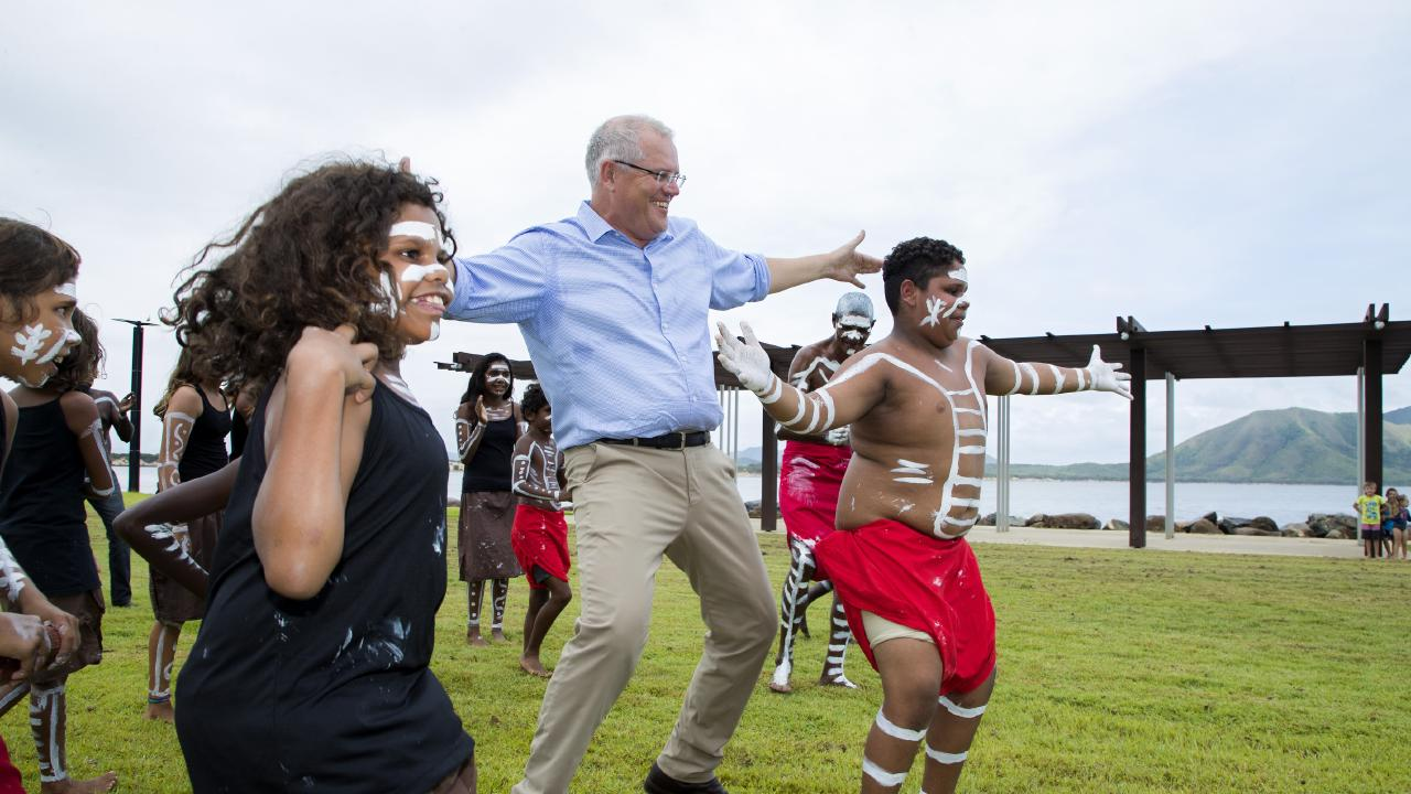 Prime Minister Scott Morrison dances with the Cooktown Dancers during a visit to Cooktown on January 22 to announce $5.5 million to support Cooktown's 2020 Festival. Picture: McCormack/AAP