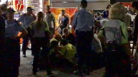 Paramedics work on a reveller at the Hardcore Till I Die festival at Homebush on Saturday.