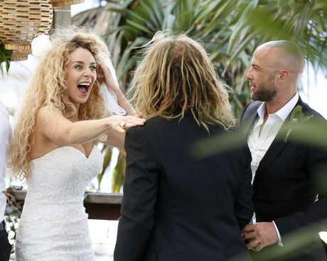Hieid meets Mike's groomsmen at their wedding reception.