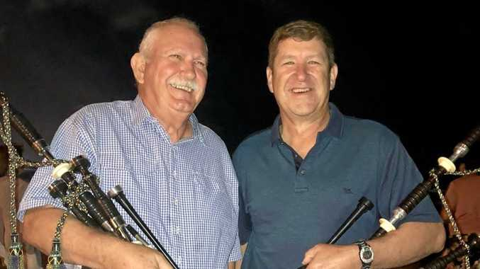 TUNING UP: Bill Stuart and Dugald MacFarlane played the bagpipes at Burleigh Beach on the Gold Coast on New Year's Eve to cheers and applause, alongside younger pipers Rory MacFarlane and Rosalie Mauch.