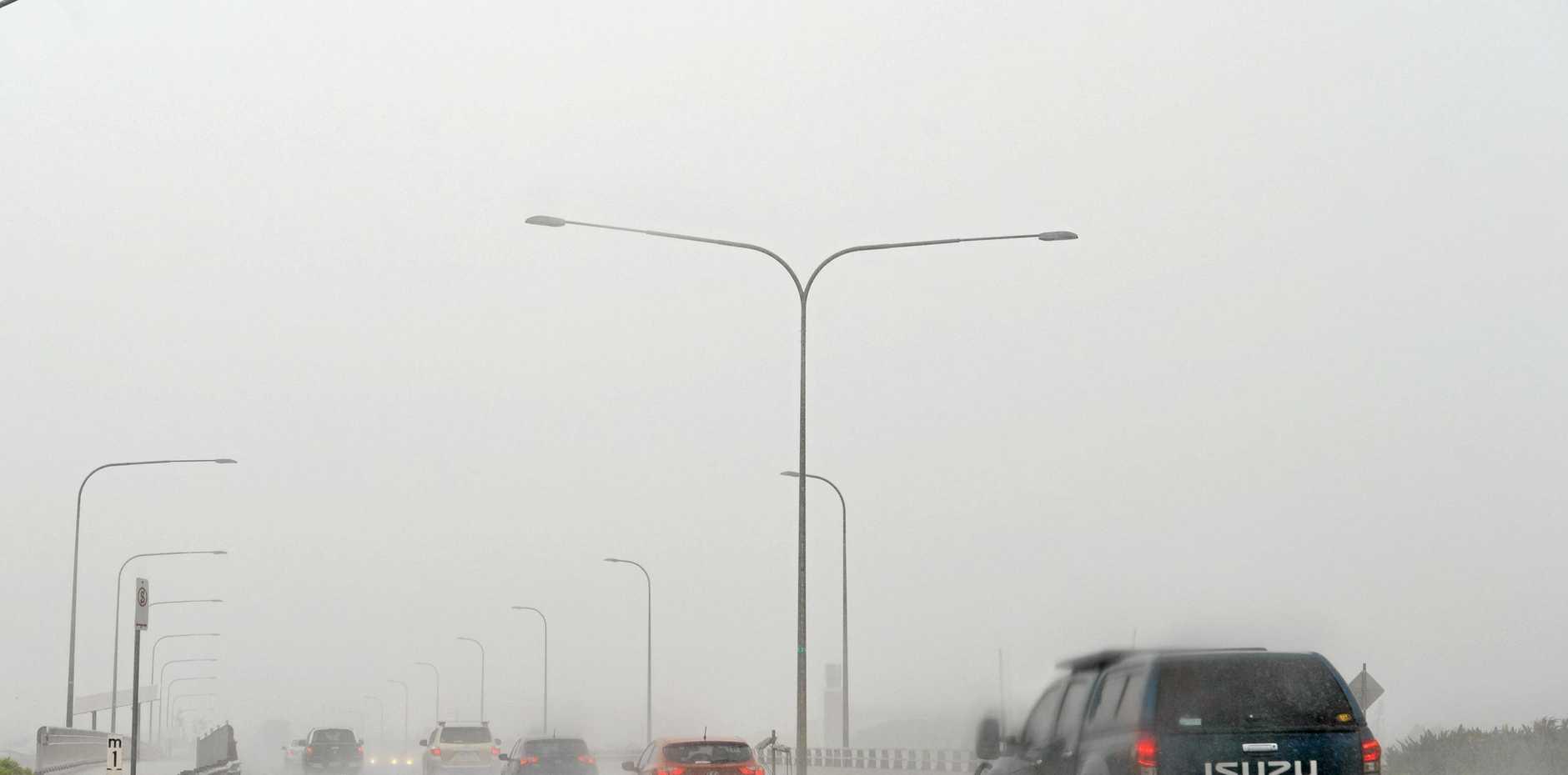 Traffic weather around Mackay. Rain on Forgan Smith Bridge.