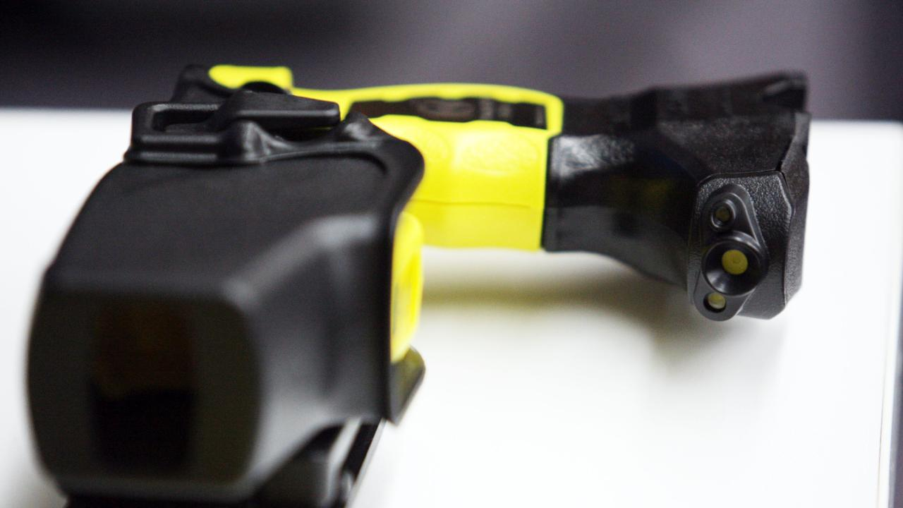 The man claimed he was using the taser as a torch.