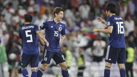 Japan players celebrate. (AP Photo/Kamran Jebreili)