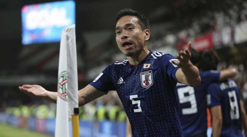 Japan's defender Yuto Nagatomo celebrates (AP Photo/Kamran Jebreili)