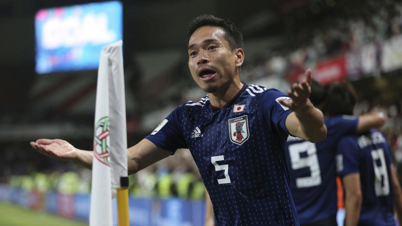 Japan's defender Yuto Nagatomo celebrates (AP Photo/Kamran Jebreili)