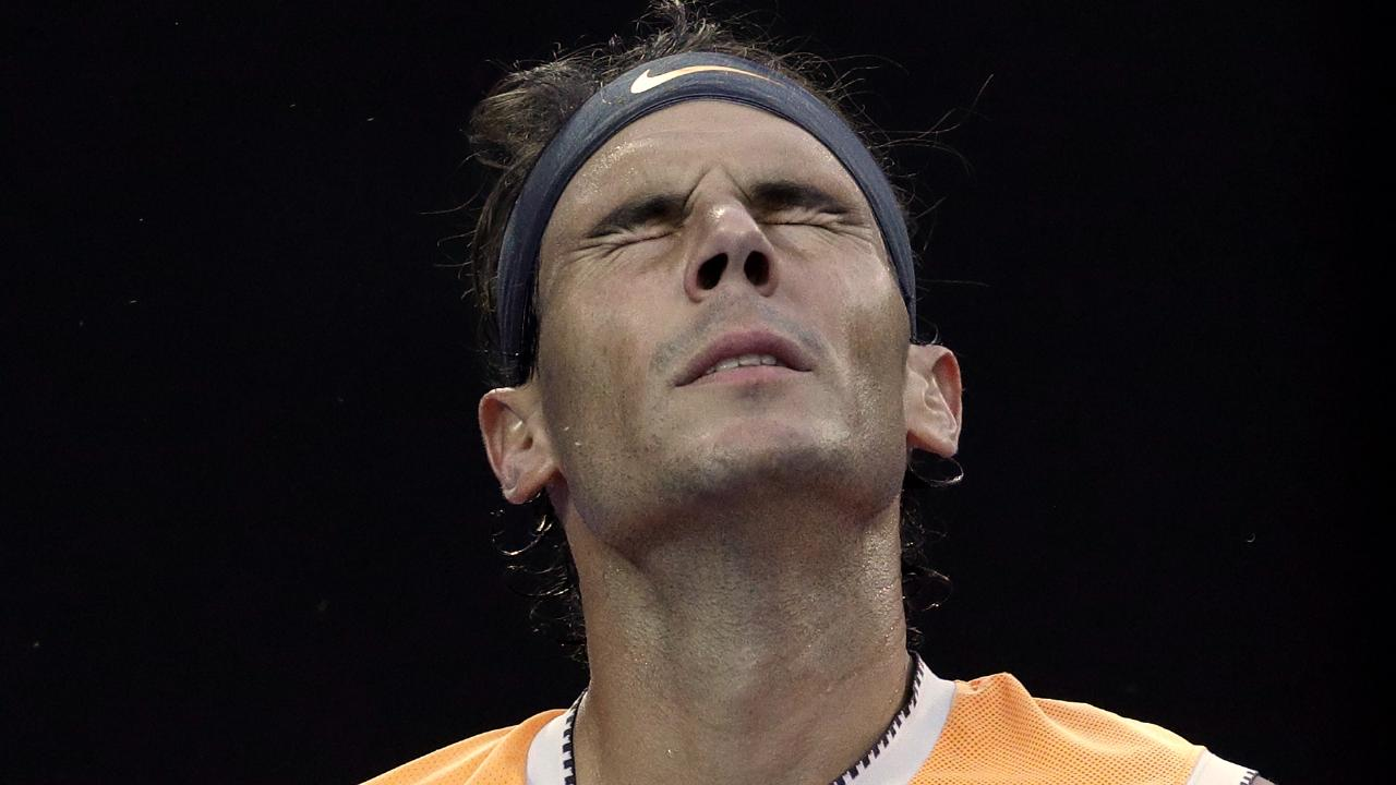 The pain of defeat is etched on Rafael Nadal's face. AP Photo/Kin Cheung
