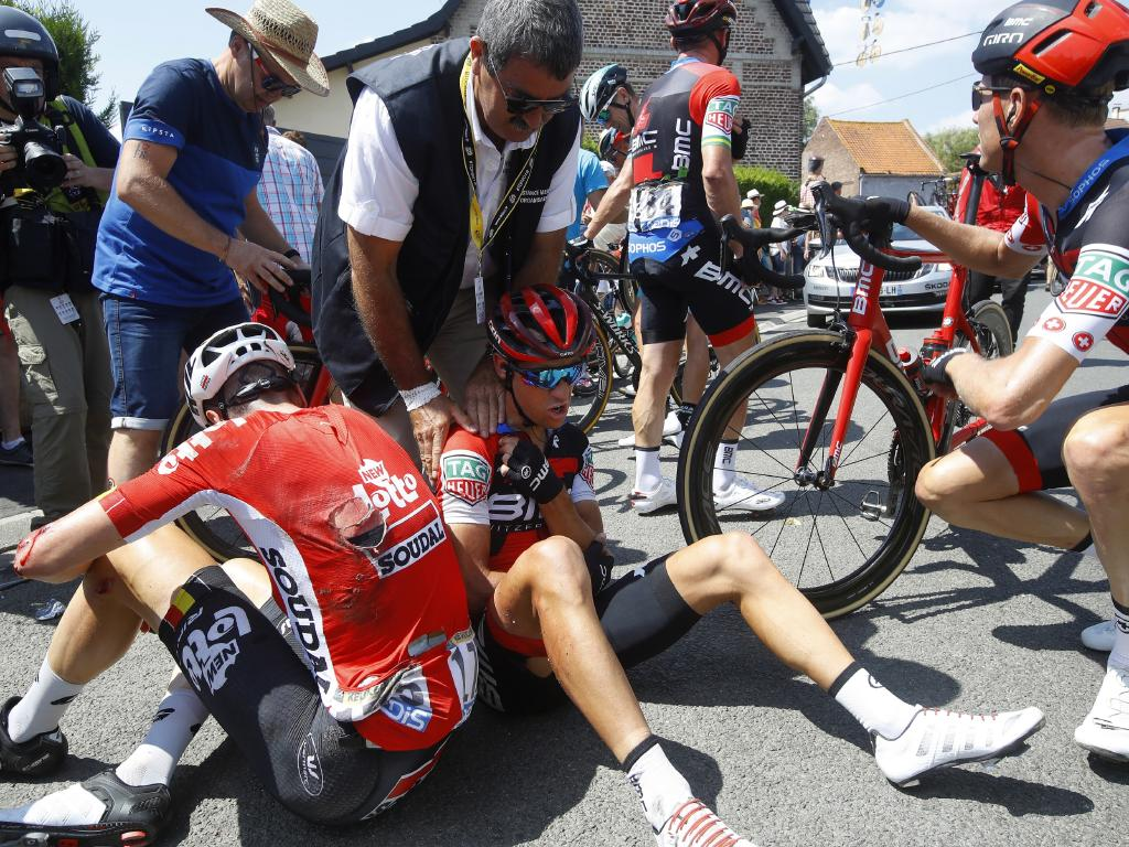Richie Porte receives medical assistance after crashing during the 9th stage of the Tour de France.