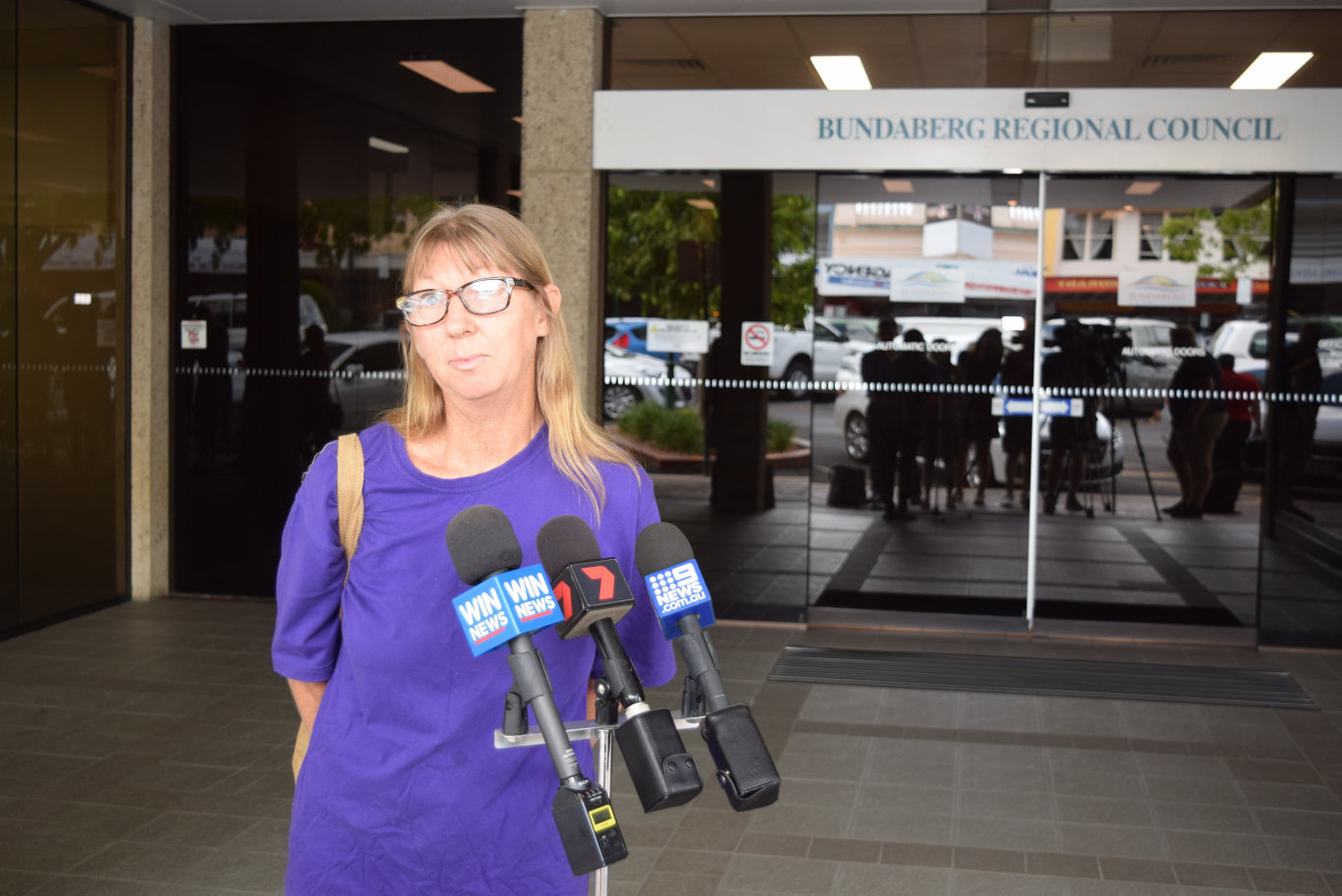 CASHLESS CARD: Anne Jackson was among a number of silent protesters who attended today's Bundaberg Regional Council meeting to demonstrate their opposition to the controversial welfare card, which rolls out in the Hinkler Electorate today.
