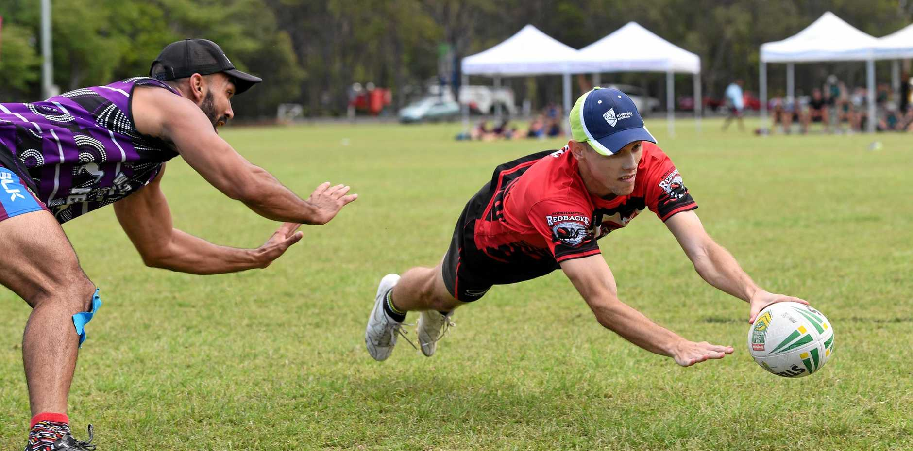 TOUCH FINAL: Jayden Benbow crosses the line during a recent Bundaberg Cup. This year's competition will see a large increase in teams competing.