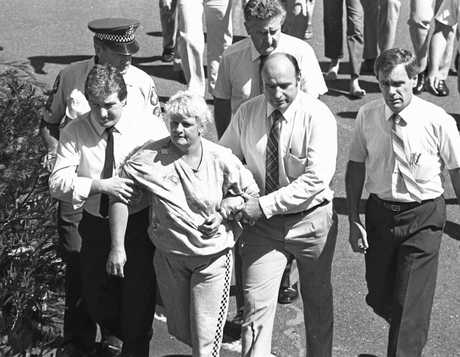 Historic: Crime: Murder Valmae Fay Beck is escorted by police, December 15, 2007, after the murder of 12 year old schoolgirl Sian Kingi  Black and White olny