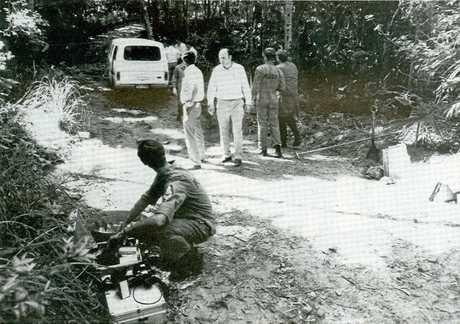 HORRIFIC: Detectives scour the scene near where Sian Kingi's body was found.