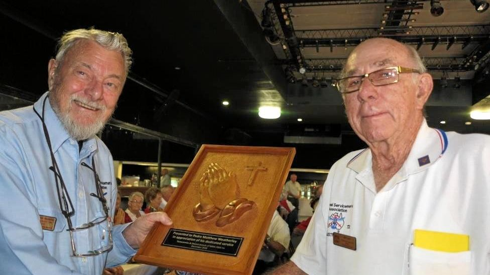 SPECIAL THANKS: A presentation was made to retiring padre Matthew Weatherley on his retirement by NSAA Toowoomba president Bill Lane. The presentation of 'The Hands' by Bill, was carved by Keith Shepherd.