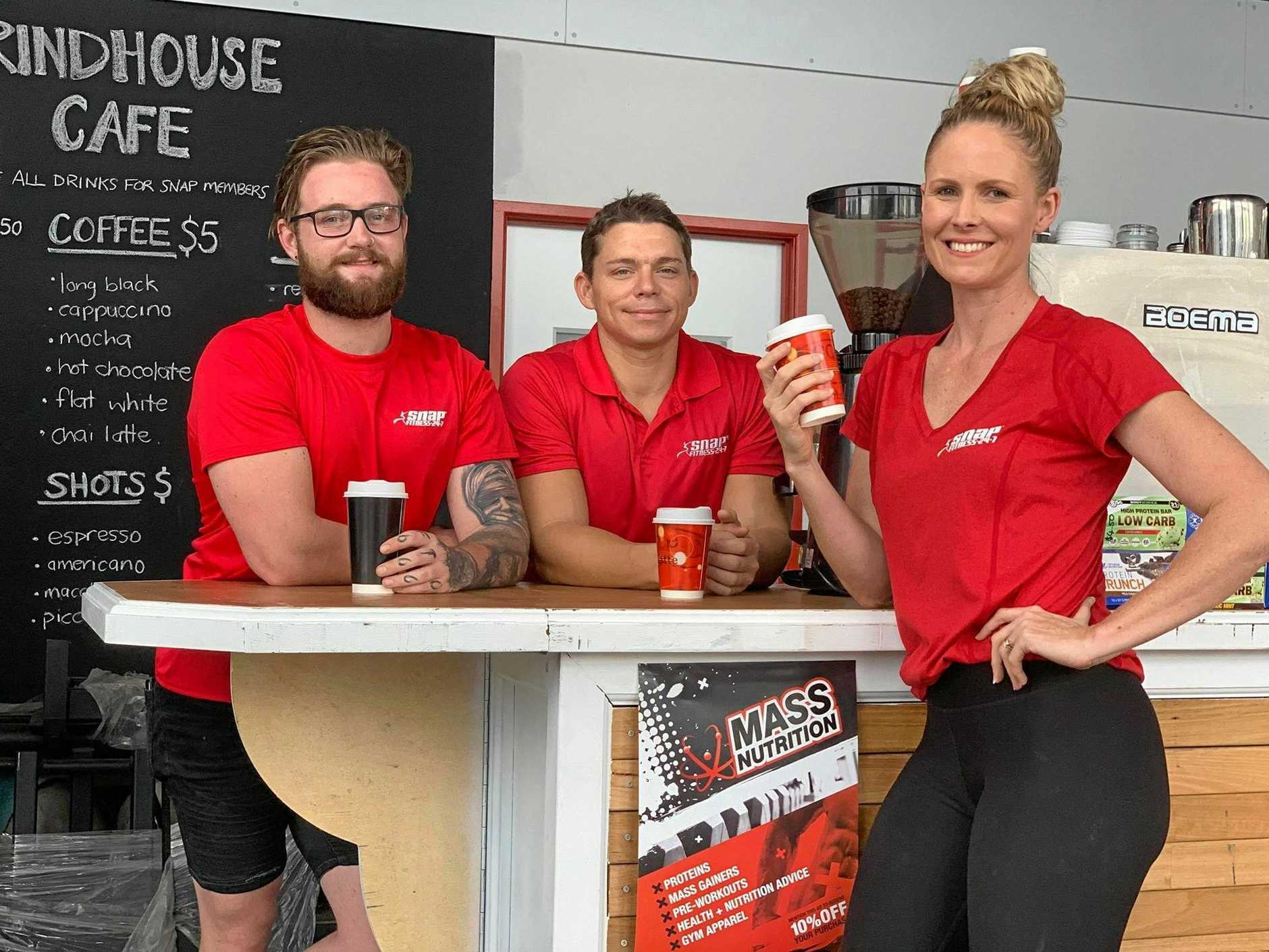 Manager of Snap Fitness North Mackay Sam Donaldson, membership consultant Bradleigh Yaworsky and area manager Tegan Iakimo inside the new Grindhouse Cafe.