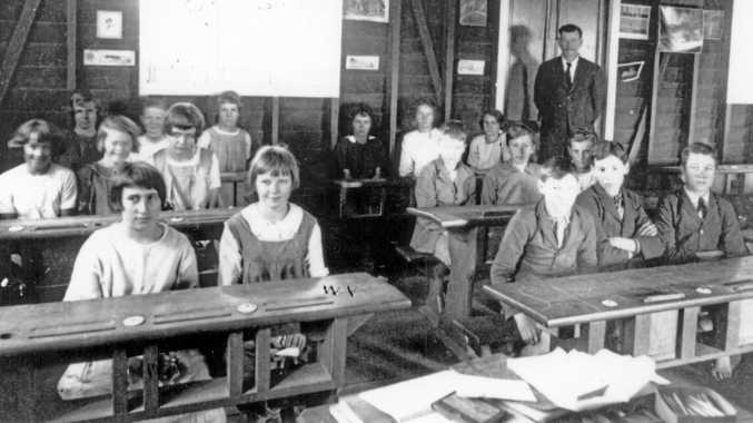 ATTENTIVE BUNCH: Students and teacher J.T. Wilson in their classroom at Woombye School, 1910.