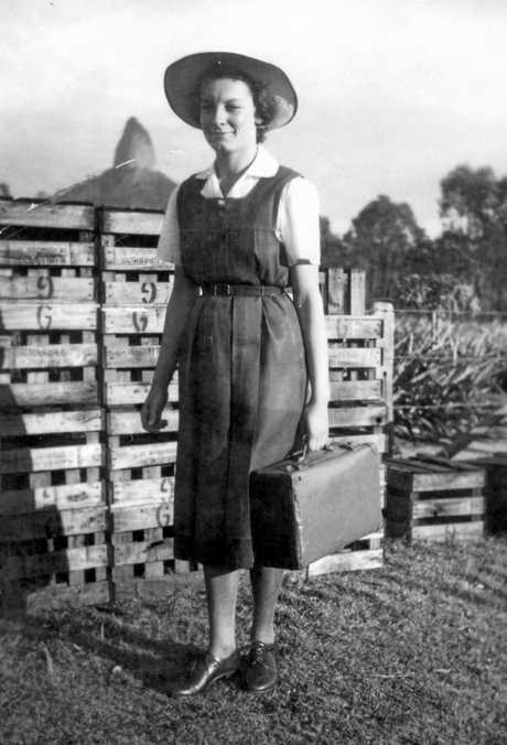 Ethel Burgess, of Glass House Mountains, off to school wearing the Nambour High School uniform, ca 1950.