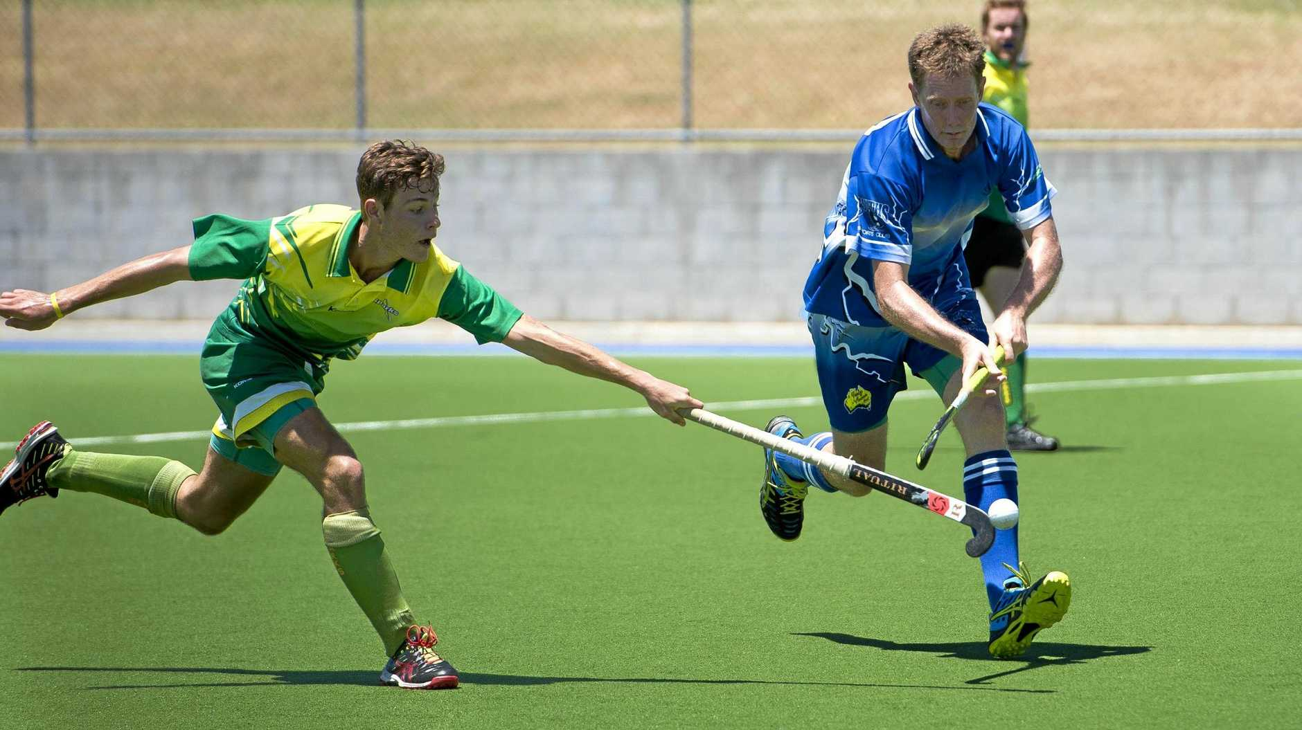 Sparks' Josh Baxter and Souths' Dean Wightman in the Gladstone Hockey 9s games between Sparks and Souths in 2017.