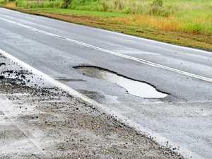 Road crews brace monsoon rains to fill one-metre pothole