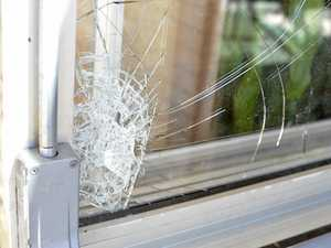 Dad uses tool to smash home window in front of mother, kids