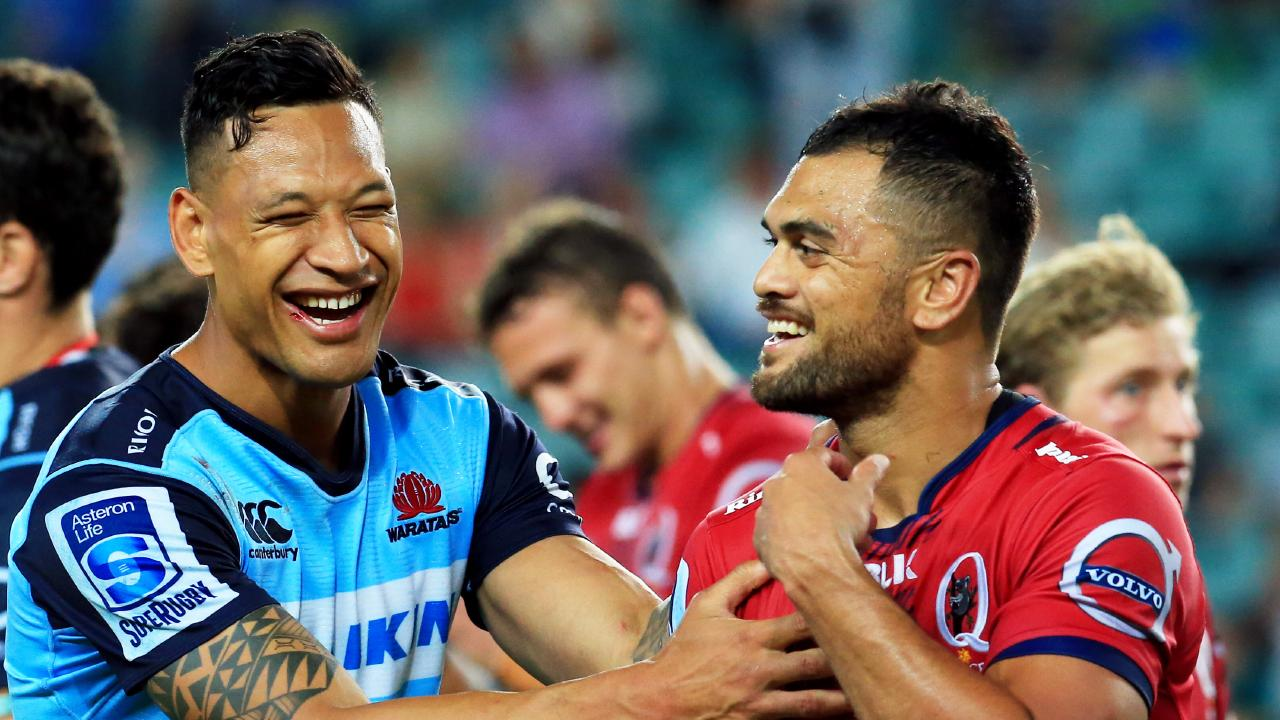 Israel Folau and Karmichael Hunt after a Waratahs-Reds game. Picture: Mark Evans