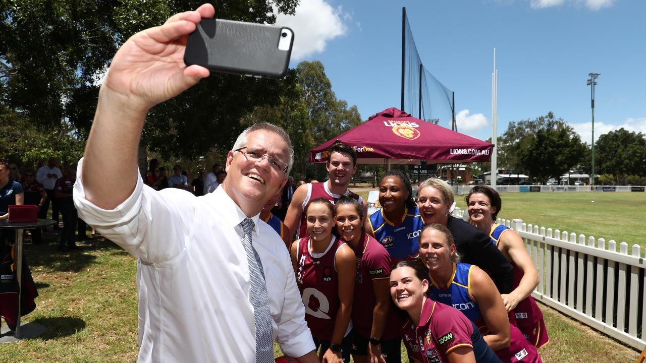 Morrison also got a happy snap with the Lions' AFLW players. Picture: Getty Images