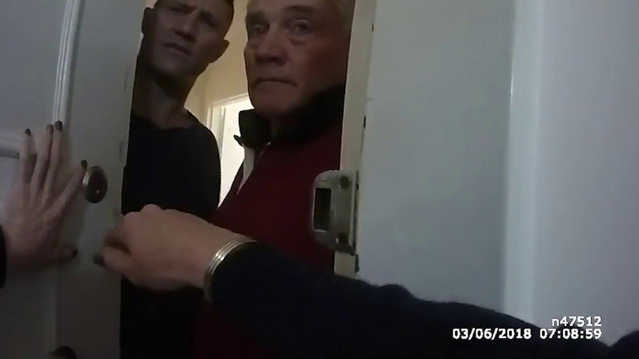 O'Donnell's father Ross answers the door with his son after the police were called. Picture: NSW Police
