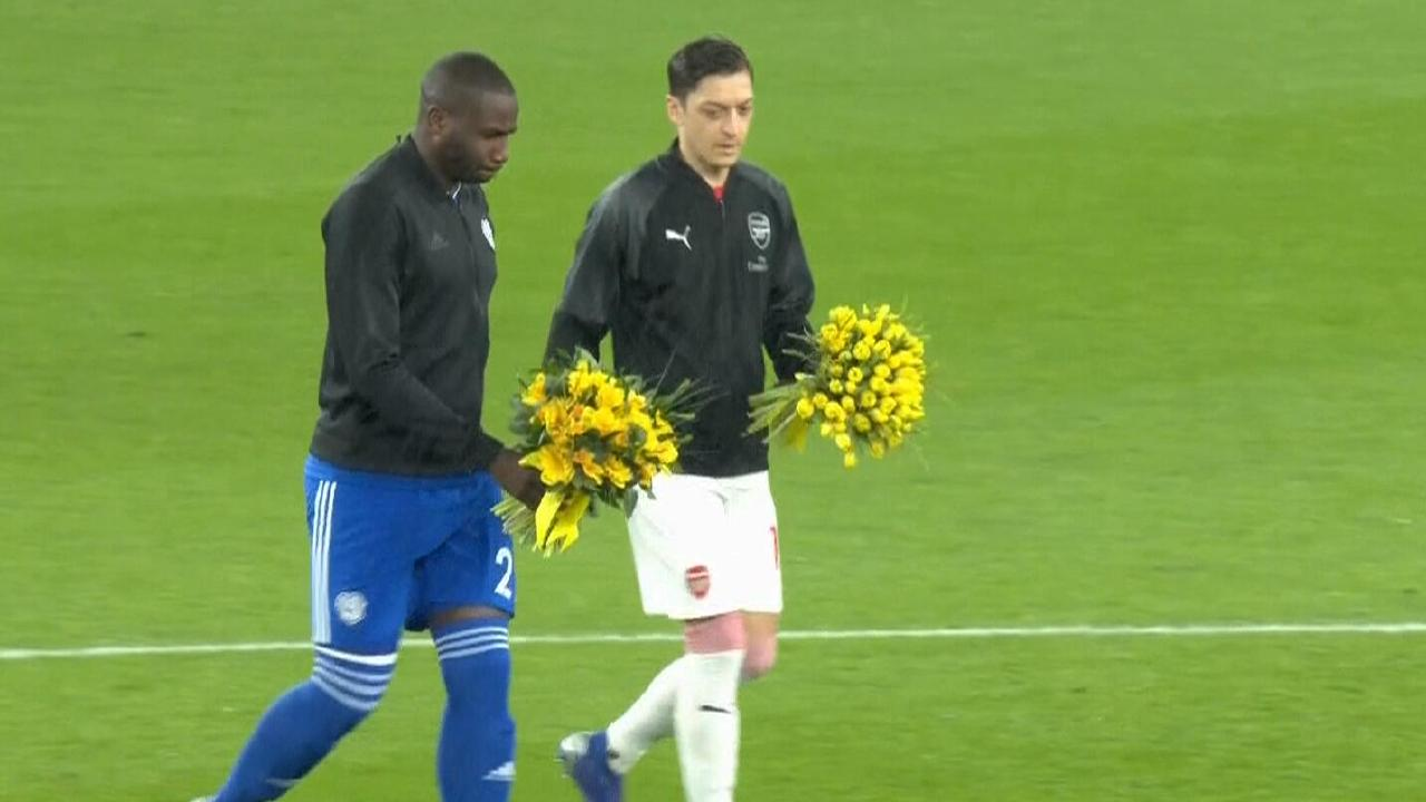The players laid out yellow daffodils