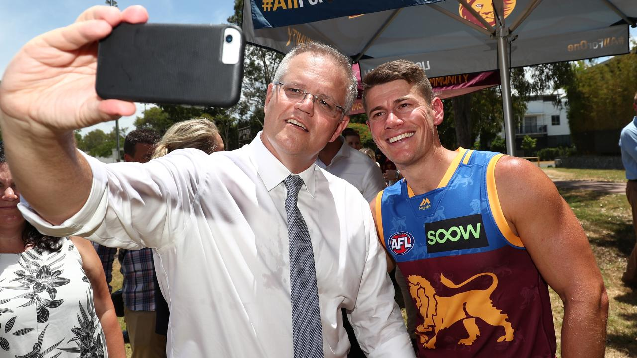 Morrison's selfie game at the announcement was strong, hamming it up with Brisbane star Dayne Zorko. Picture: Getty Images