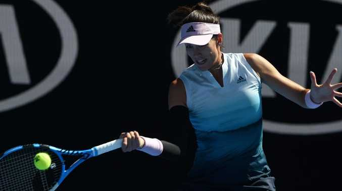 Spain's Garbine Muguruza was up the other end when Sabine Lisicki got quite the shock. Greg Wood/AFP