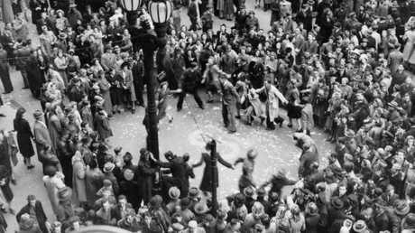 Crowds celebrating in Bourke Street, Melbourne on VP Day in 1945. Picture: Australian War Memorial.