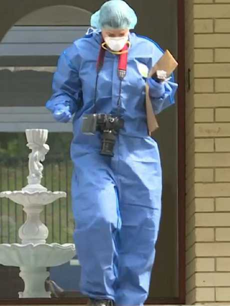 A police forensics officer outside the Rockhampton home. Picture: 9 News