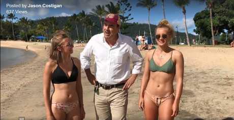 Whitsunday MP Jason Costigan posing with tourists for International Bikini Day last year.