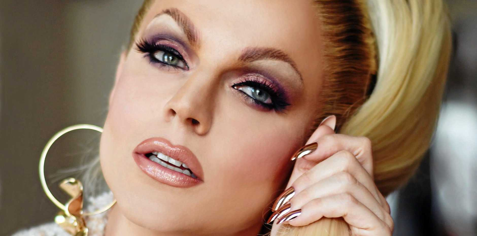 BEAUTY KING: Shane Jenek, also known as Courtney Act, is an Australian drag queen, pop singer, entertainer and reality television personality.