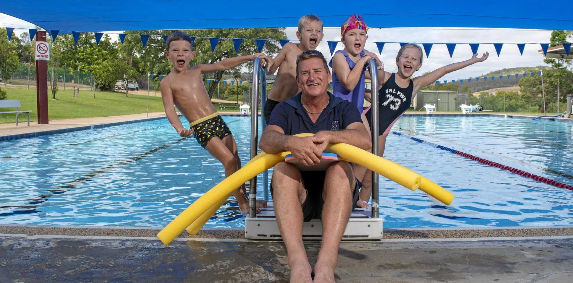 FAREWELL COACH: Fraser Sippel, Riley Sippel, Kayleigh Williams and Sienna Sippel poolside with Lowood pool manager Darren Booth.