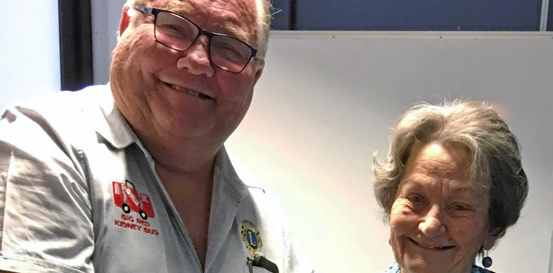 GIVING BACK: Robina Lions Club president John Clark presents Robina Red Cross president and Lions Club board member Toula Singer OAM with a cheque.