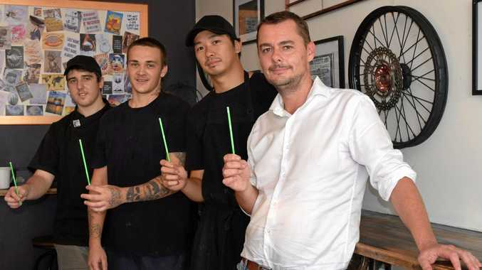 WASTE WARRIORS: Edison's Burger Bar employees Kallum McColl, Lachlan Millar and Joshua Yam with CQ Catering Services general manager Brian Collis.