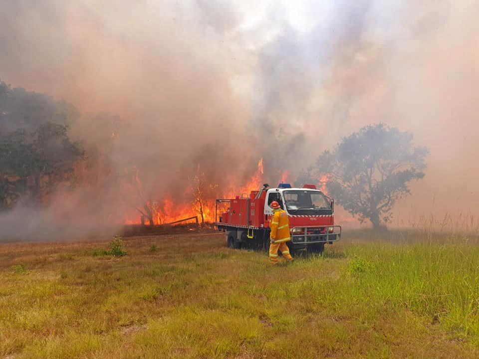 Fire crews are working to contain a bushfire burning near Coffs Harbour.